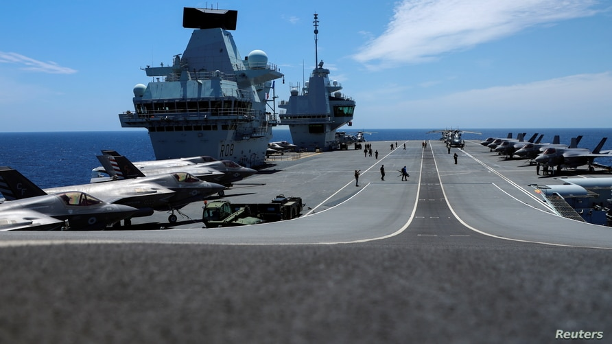 F-35B Lightning II aircrafts are seen on the deck of the HMS Queen Elizabeth aircraft carrier offshore Portugal, May 27, 2021.