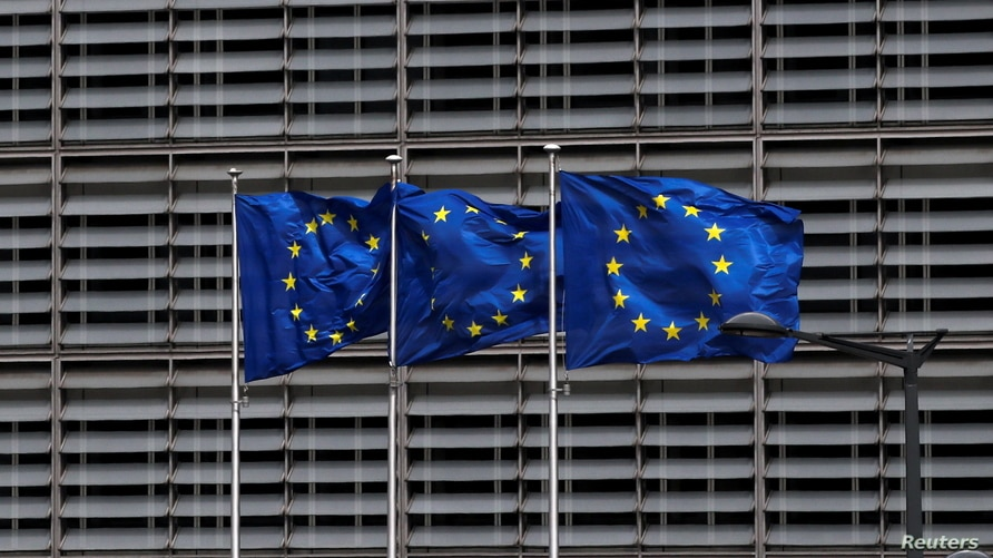 FILE PHOTO: European Union flags flutter outside the EU Commission headquarters in Brussels, Belgium May 5, 2021. REUTERS/Yves…
