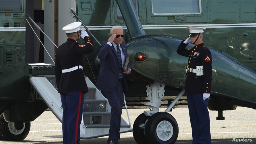 U.S. President Joe Biden salutes as he steps from Marine One upon his arrival in Rehoboth Beach, Delaware, June 2, 2021.