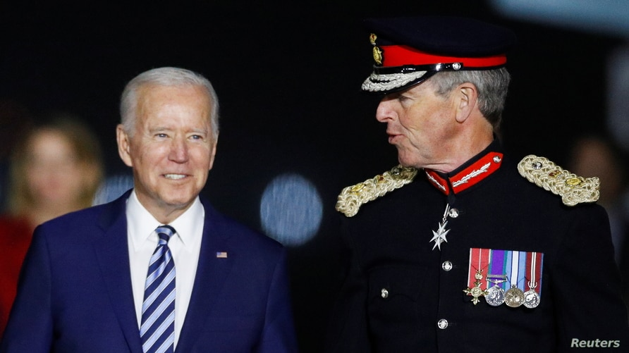 U.S. President Joe Biden is welcomed as he arrives at Cornwall Airport Newquay, near Newquay, Cornwall, Britain June 9, 2021.