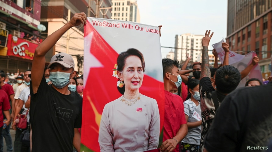 FILE - Demonstrators protest against the military coup and demand the release of elected leader Aung San Suu Kyi.
