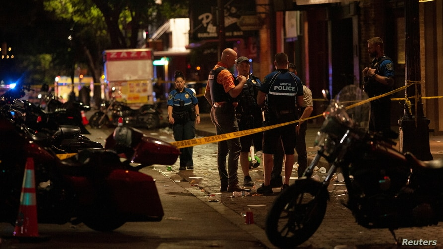 Police investigate the scene of a mass shooting in the Sixth Street entertainment district area of Austin, Texas, U.S. June 12,…