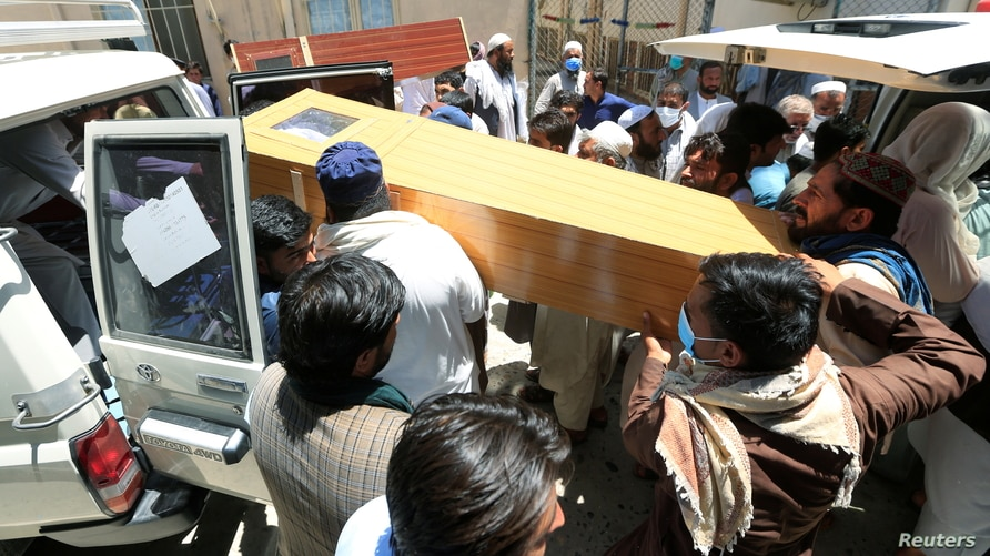 Afghan men carry the coffin of one of polio vaccination health workers shot and killed by unknown gunmen at separate locations…