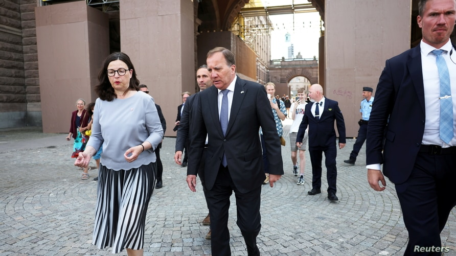 Sweden's Prime Minister Stefan Lofven and Minister of Education Anna Ekstrom walk after the no-confidence vote in the Swedish…
