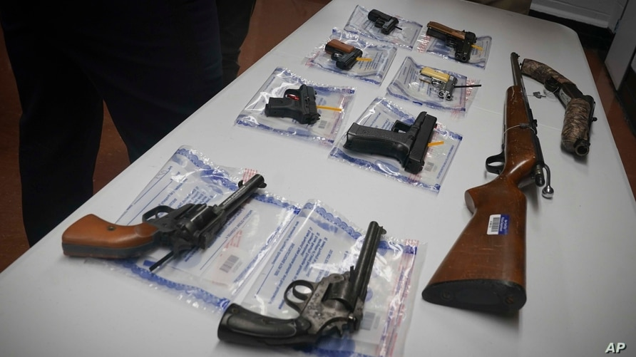 A collection of illegal guns is displayed during a gun buyback event, Saturday May 22, 2021 in Brooklyn, N.Y. Guns were handed…