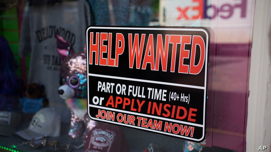 A sign for workers hangs in the window of a shop along Main Street in Deadwood, S.D. U.S. employers added 559,000 jobs in May, an improvement from April's sluggish gain, May 26, 2021.