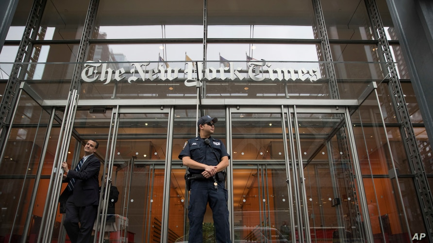 FILE - In this June 28, 2018, file photo, a police officer stands outside The New York Times building in New York.