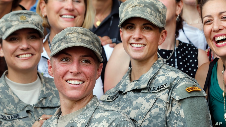 FILE - Army 1st Lt. Shaye Haver, center, and Capt. Kristen Griest, right, pose in this Aug. 21, 2015 photo.