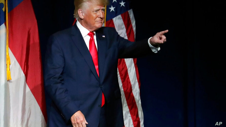Former President Donald Trump acknowledges the crowd as he speaks at the North Carolina Republican Convention Saturday, June 5,…