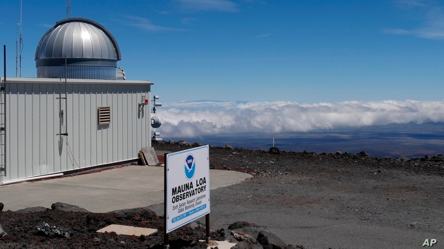 This 2019 photo provided by NOAA shows the Mauna Loa Atmospheric Baseline Observatory, high atop Hawaii's largest mountain in…