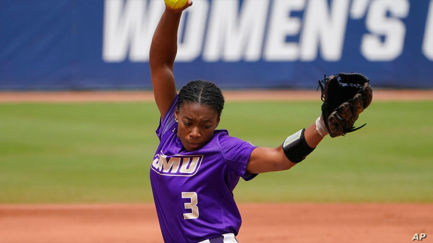 James Madison's Odicci Alexander (3) pitches during an NCAA Women's College World Series softball game against Oklahoma, Monday…