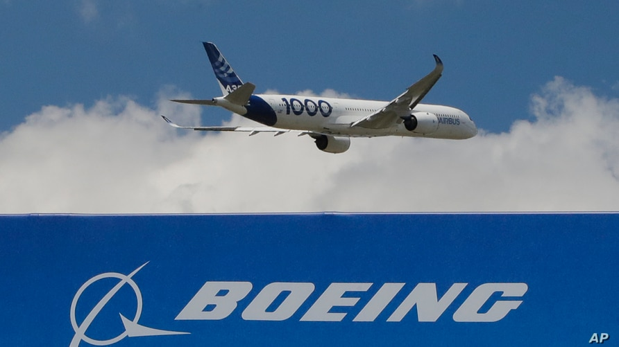 FILE - An Airbus A 350 - 1000 performs a demonstration flight at Paris Air Show in Le Bourget, east of Paris, France.