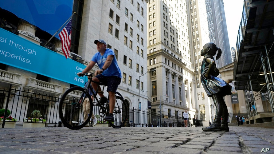 """The """"Fearless Girl"""" statue faces the New York Stock Exchange, Wednesday, June 16, 2021. Stocks are off to a mixed start on Wall…"""