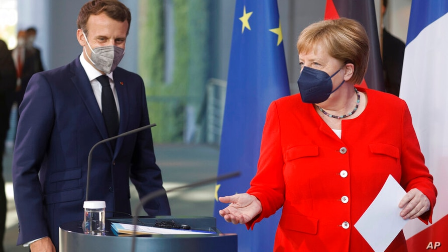 German Chancellor Angela Merkel, right, and French President Emmanuel Macron give a joint statement to journalists, at the…