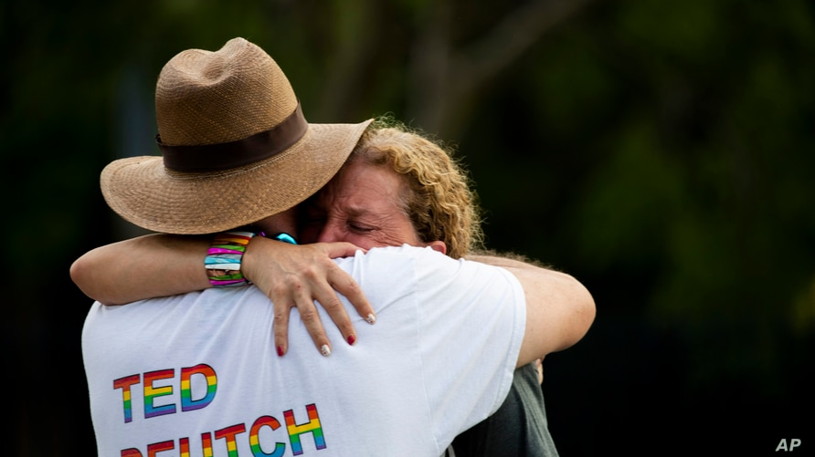Rep. Debbie Wasserman Schultz, D-Fla., is comforted after a truck drove into a crowd of people during The Stonewall Pride…