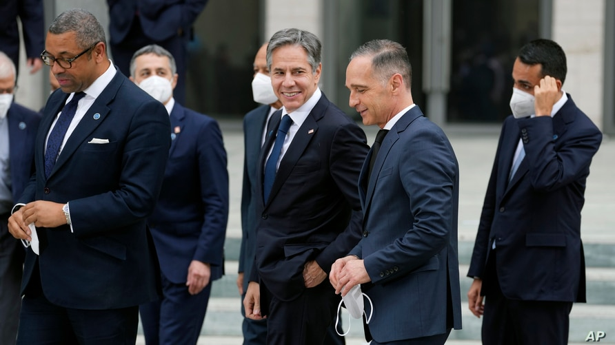 German Foreign Minister Heiko Maas, center right, and U.S. Secretary of State Antony Blinken, center left, talk after group photo.