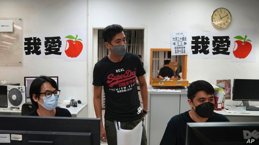 Staff members design their layout for the last edition of newspaper in the Apple Daily headquarters in Hong Kong, June 23, 2021.