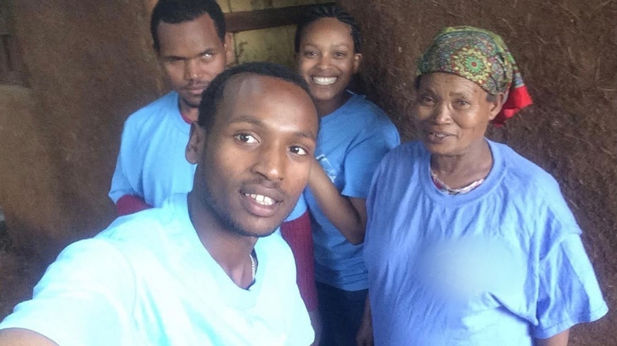 Adoptee Amarech Kebede Richmond, at center rear, poses with her biological mother and brothers during a visit to Ethiopia.