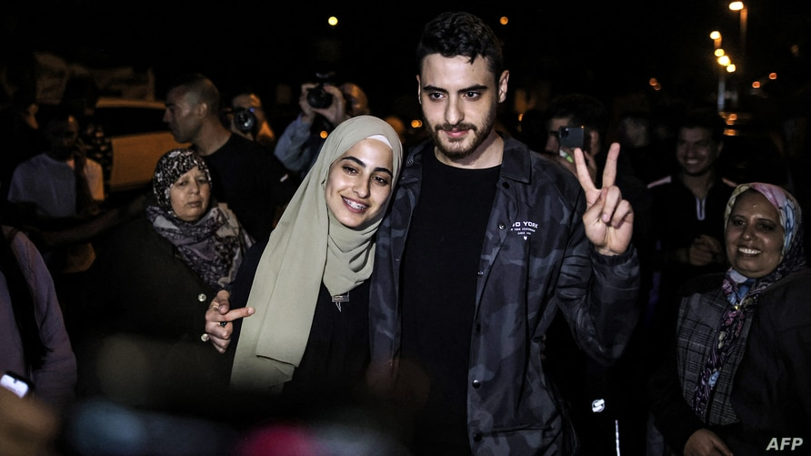 Palestinian activist twins Mona and Muhammad el-Kurd pose for a photo after being released by Israeli authorities in the neighbourhood of Sheikh Jarrah in Israeli-annexed east Jerusalem, June 6, 2021.