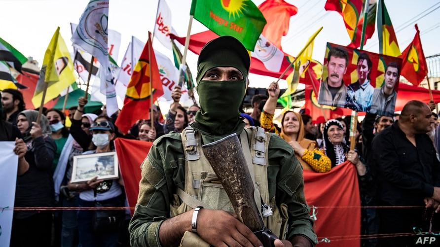 Syrian Kurds demonstrate, June 10, 2021, in the northeastern Syrian city of Qamishli against the Turkish offensive on Kurdistan Workers' Party (PKK) areas in northern Iraq.