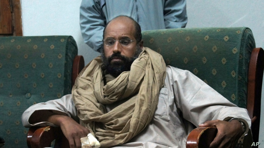 FILE - In this Nov. 19, 2011, file photo, Seif al-Islam is seen after his capture in the custody of revolutionary fighters in…