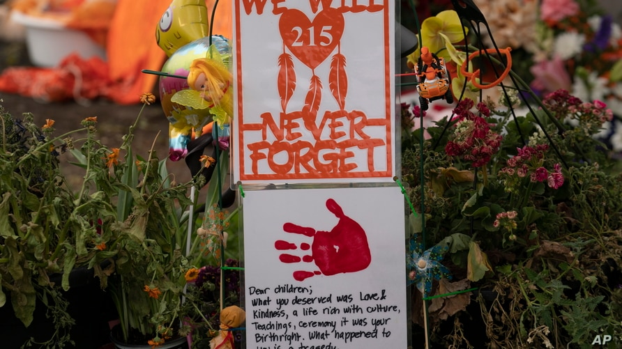 A memorial is seen outside the Residential School in Kamloops, British Columbia., Sunday, June, 13, 2021. The remains of 215…