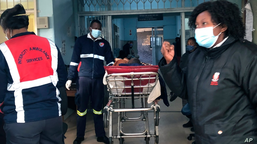 A COVID-19 patient is admitted to a hospital in Johannesburg, Wednesday, June 23, 2021. South Africa's third wave of COVID-19…