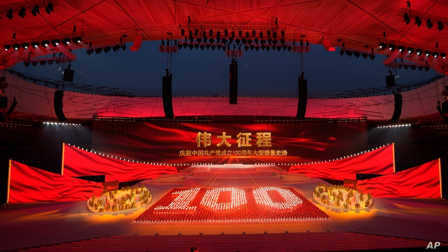Performers form the number 100 at a gala show ahead of the 100th anniversary of the founding of the Chinese Communist Party.