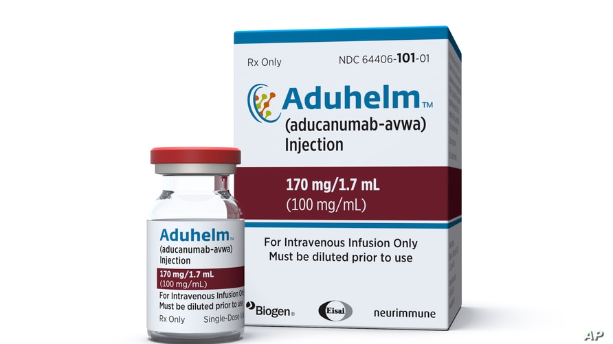 This image provided by Biogen, June 7, 2021 shows a vial and packaging for the drug Aduhelm.