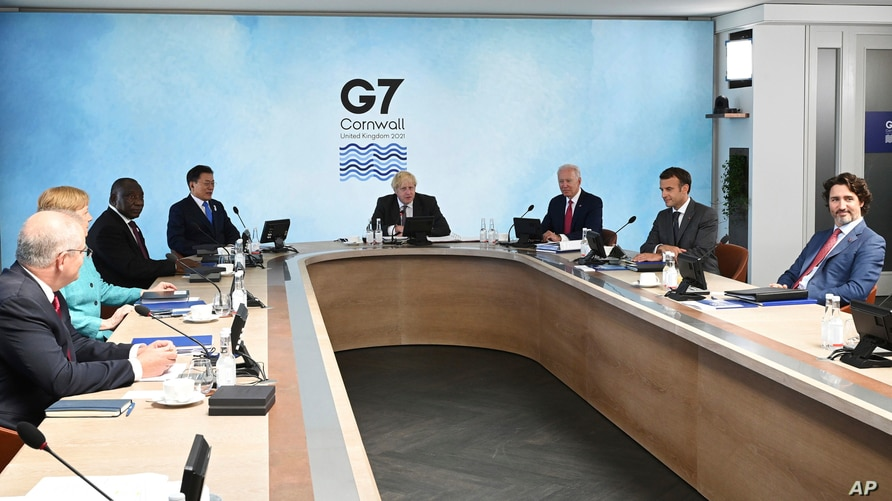 G-7 summit participants are seen during a session in Cornwall, England, June 12, 2021.