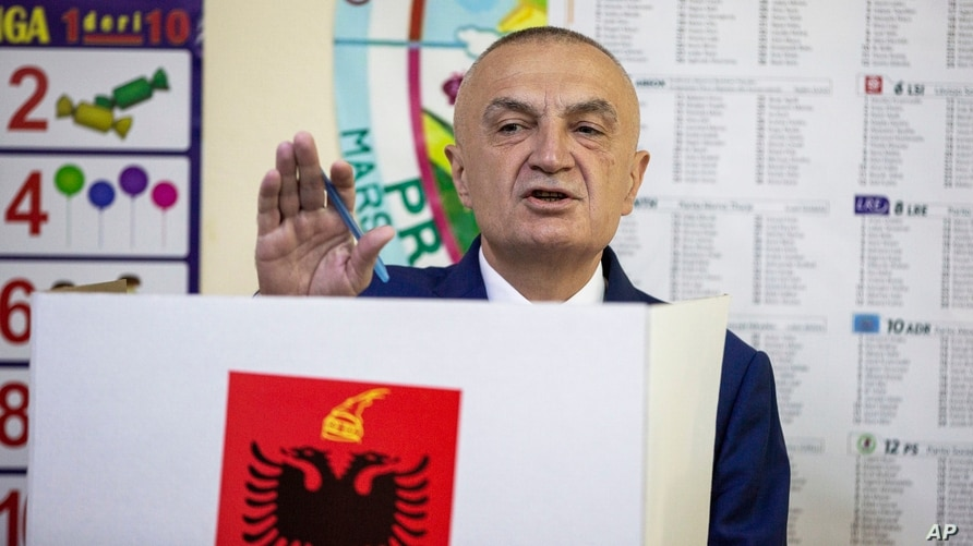 FILE - Albanian President Ilir Meta gestures as he votes during parliamentary elections in the capital Tirana, Albania, April 25, 2021.