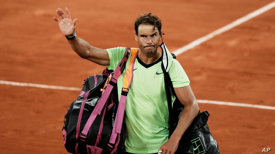 FILE - Spain's Rafael Nadal waves to the crowd after losing to Serbia's Novak Djokovic in their semifinal match of the French Open tennis tournament at the Roland Garros stadium in Paris, June 11, 2021.