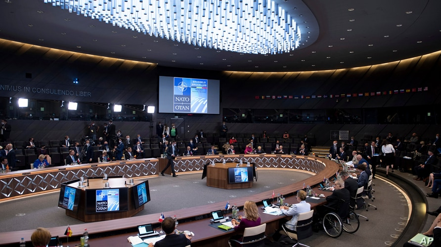 NATO leaders attend a plenary session during their summit at the alliance's headquarters in Brussels, June 14, 2021.