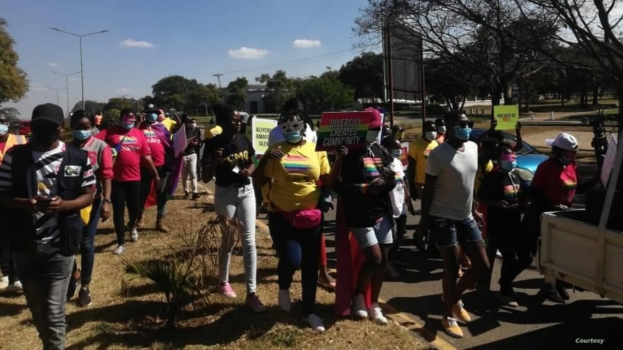 Some of members of the LGBTI community covered their faces not only with protective masks to hide their identity during the parade Saturday. (Courtesy of Nyasa Rainbow Alliance)