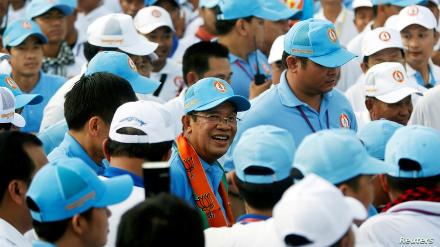 FILE - President of the Cambodian People's Party (CPP) and Cambodia's Prime Minister Hun Sen (C) marches with supporters ahead of elections, in Phnom Penh, Cambodia, July 27, 2018.