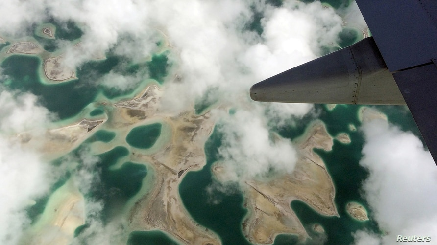 FILE - Lagoons can be seen from a plane as it flies above Kiritimati Island, part of the Pacific island nation of Kiribati, April 5, 2016.