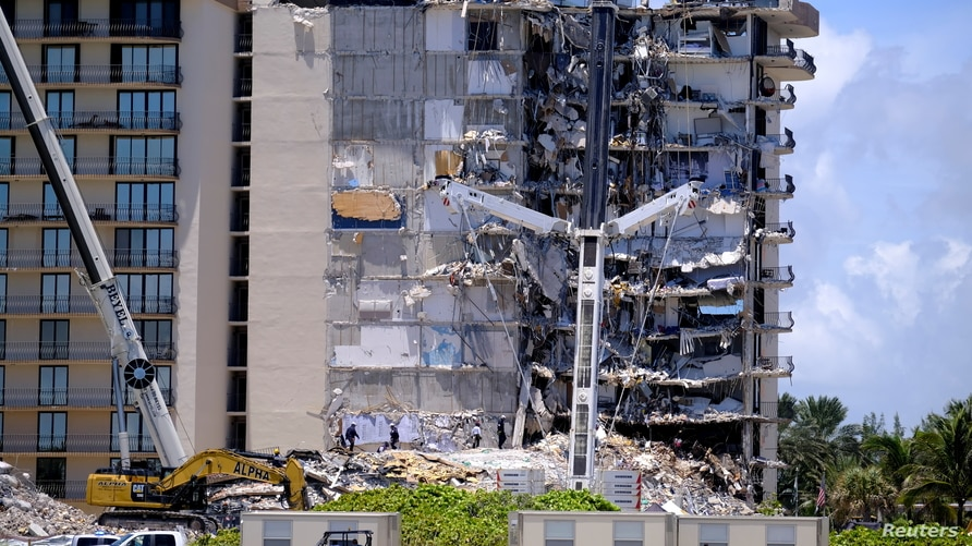 Search and rescue personnel continue searching for victims days after a residential building partially collapsed in Surfside, near Miami Beach, Florida, June 27, 2021.