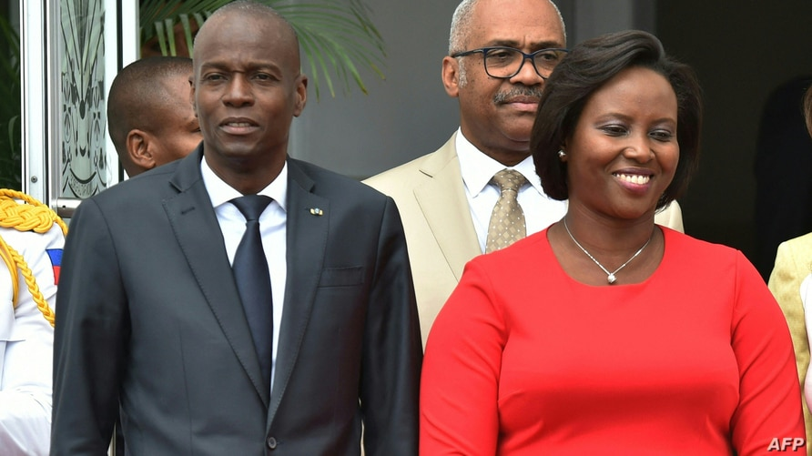 (FILES) In this file photo taken on May 23, 2018, Haitian President Jovenel Moise (L) and Haitian First Lady Martine Moise are…