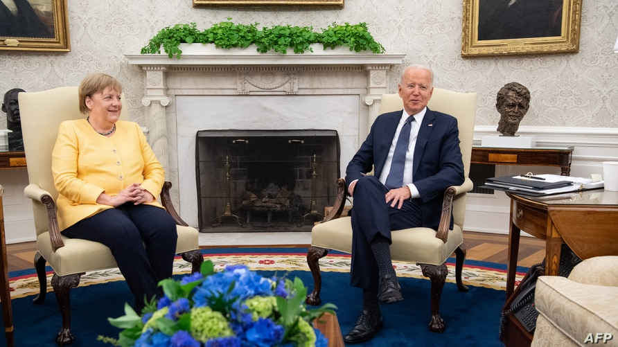 US President Joe Biden and German Chancellor Angela Merkel hold a meeting in the Oval Office of the White House in Washington,…