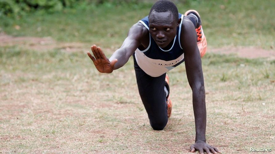 FILE - Paulo Amotun Lokoro, a refugee from South Sudan, part of the refugee athletes who qualified for the 2016 Rio Olympics, stretches during a training session in Ngong township near Kenya's capital Nairobi, June 9, 2016.