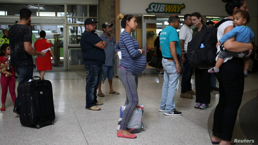 A pregnant woman from Honduras is released from detention with other undocumented immigrants at a bus depot in McAllen, Texas,…
