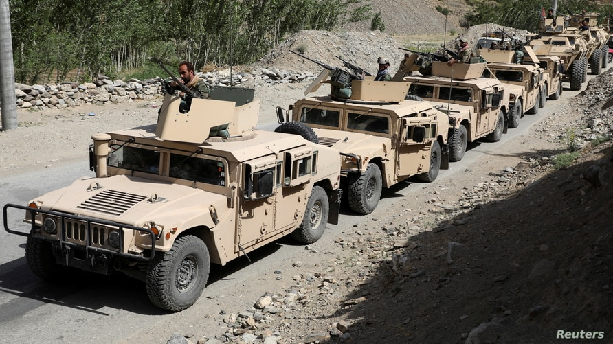 Afghan Commando forces armoured convoy leaves toward the front line, at the Ghorband District, Parwan Province Afghanistan June…