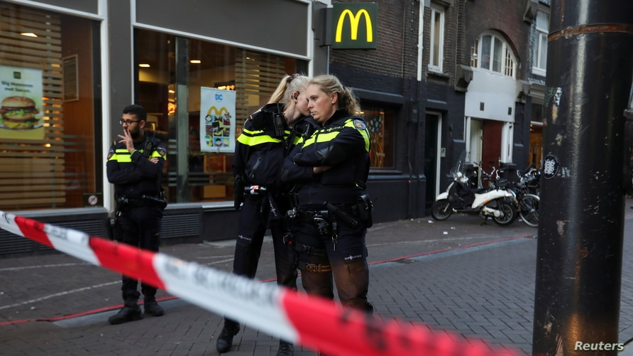 Police officers stand guard to secure the area where Dutch celebrity crime reporter Peter R. de Vries, known for his reporting…