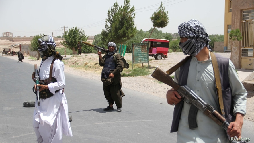 Former Mujahideen hold weapons to support Afghan forces in their fight against Taliban, on the outskirts of Herat province,…