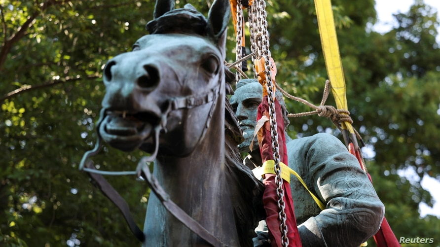 """A statue of Confederate General Thomas """"Stonewall"""" Jackson is removed after years of a legal battle over the contentious…"""