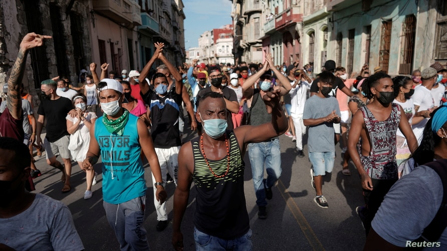 People shout slogans against the government during a protest against and in support of the government, amidst the coronavirus…