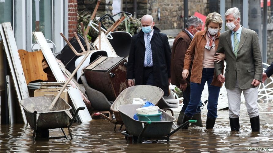 King Philippe and Queen Mathilde of Belgium visit an area affected by floods, following heavy rainfalls, in Pepinster, Belgium, July 16, 2021.