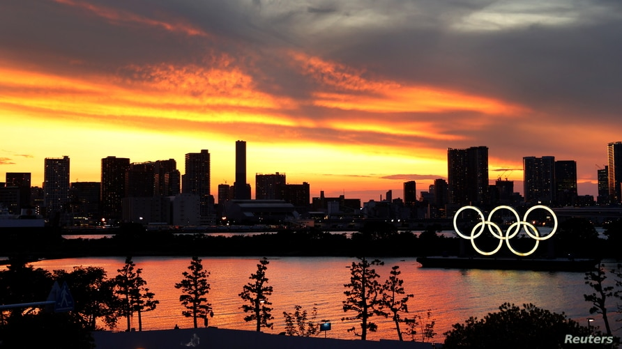 The Olympic Rings are seen in front of the skyline during sunset, three days ahead of the official opening of the Tokyo 2020…
