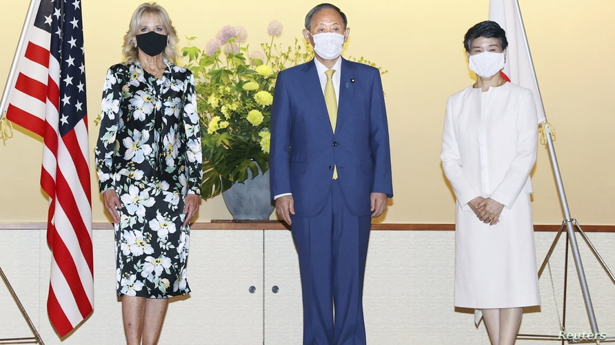U.S. First Lady Jill Biden meets with Japan's Prime Minister Yoshihide Suga and his wife Mariko Suga at Akasaka Palace State Guest House ahead of the opening of theTokyo 2020 Olympic Games in Tokyo, Japan, July 22, 2021, in this photo released by Kyodo.