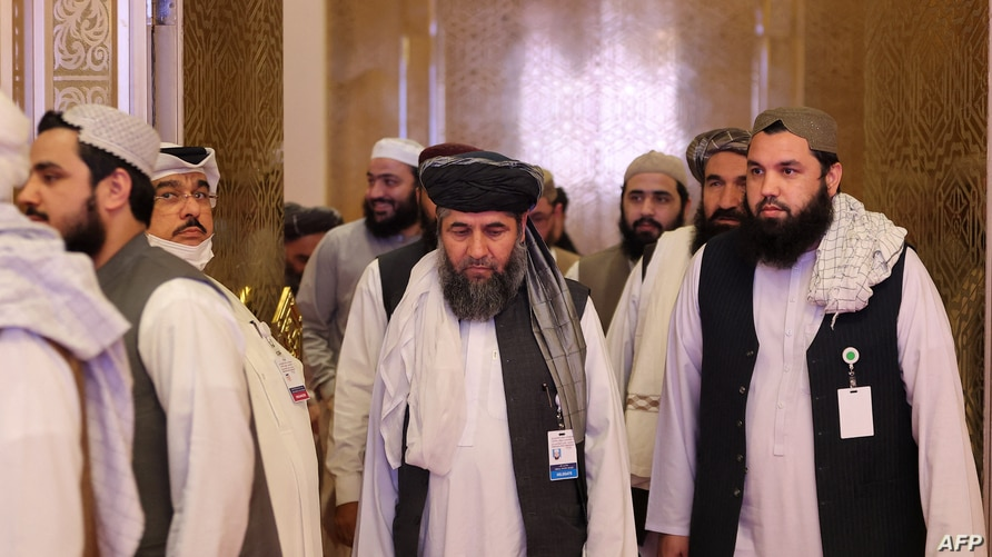 Members of the Taliban delegation are seen at the conclusion of peace talks between the Afghan government and the Taliban, in Doha, Qatar, July 18, 2021.
